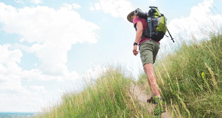 Tall man hiking with a backpack